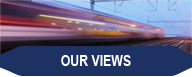 "Image of a speeding commuter train, with the words ""Our Views"""